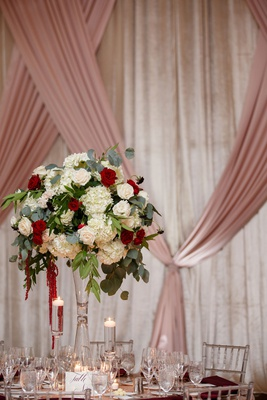 wedding reception pink drapes ballroom tall centerpiece white hydrangea red rose amaranthus fall