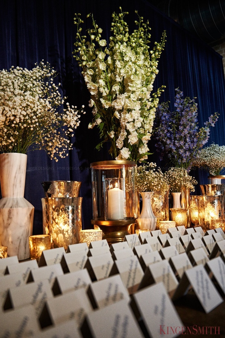 Tall floral & variety of candles adding to placecard table.