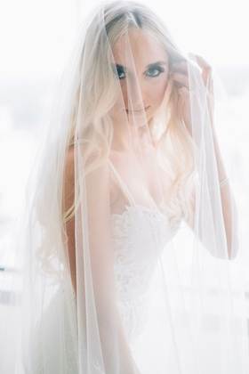 Bride with pretty eyes and makeup long blonde hair berta wedding dress under veil