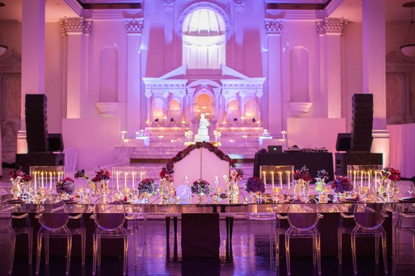 Bride and groom bench at mirror head table with ghost chairs for wedding party at Vibiana