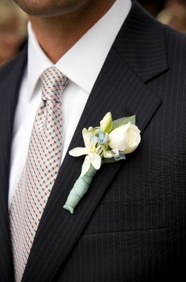 Groom in pinstripe suit with flowers on lapel