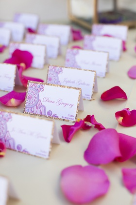 south asian wedding, detailed escort card with gold border, pink rose petals