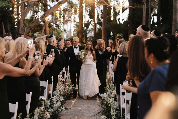 bride walking down aisle with mother and father beverly hills outdoor ceremony string lights