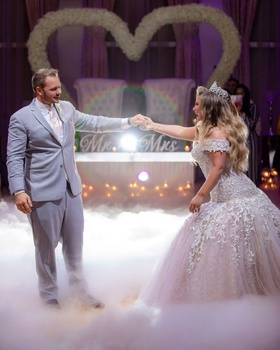wedding reception ashley alexiss first dance on dance floor with smoke in front of sweetheart table