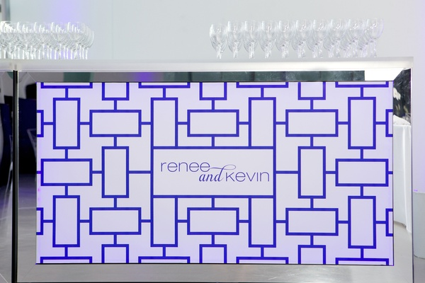 Illuminated blue and white wedding bar with couple names