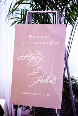 pink purple wedding welcome sign for stacy john silver easel hotel wedding