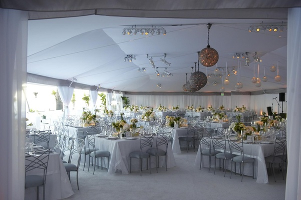Classic tented wedding with white flowers and silver accents
