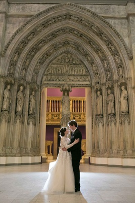 newlyweds embracing roman catholic church pittsburgh pa liancarlo wedding dress religious ceremony