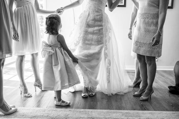 Flower girl helping bride getting ready in La Jolla CA