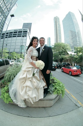Bride in ball gown and groom in front of Chicago skyline