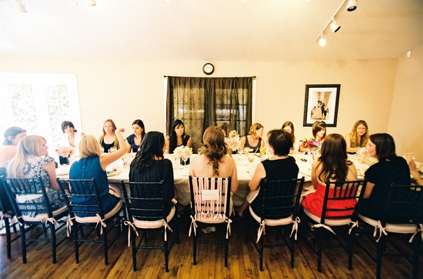 Bridal shower guests at long table