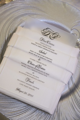 Lucite card with black lettering on white napkin