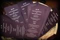 Ceremony programs in dark eggplant purple