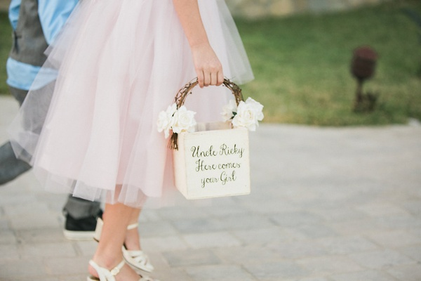 flower girl in pink tulle dress and white wedge heels with basket uncle ricky here comes your girl