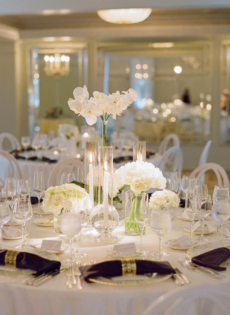 wedding reception white flower centerpiece rose hydrangea orchid napkin gold ring hotel casa del mar