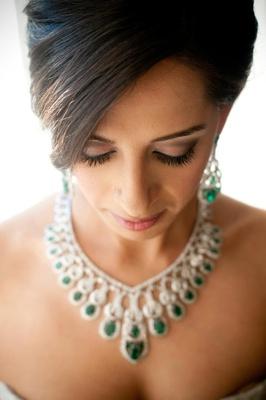 Indian bride wearing jewelry and smokey-eye