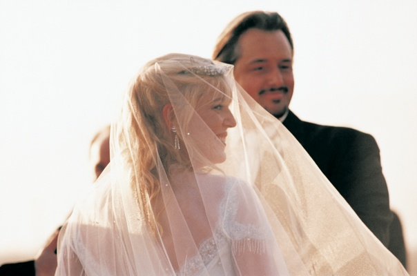 bride wears veil during ceremony