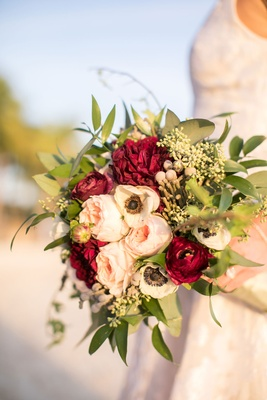 Wedding bridal bouquet with garden rose, red burgundy ranunculus flowers, greenery and brunia