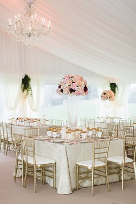 Wedding reception square table ivory linen gold chair gold glassware tall pink flowers glass vase