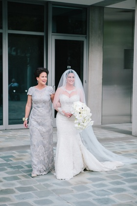 mother of the bride walks bride down the aisle, bride in martina liana gown and blusher veil