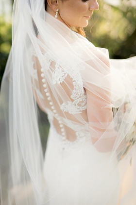 veil over semi illusion back gown wedding buttons lace details
