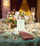 Wedding reception vintage inspired light blue linen with embellishments embroidery pink napkin