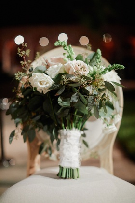 bridal bouquet with heavy greenery, blush and white roses