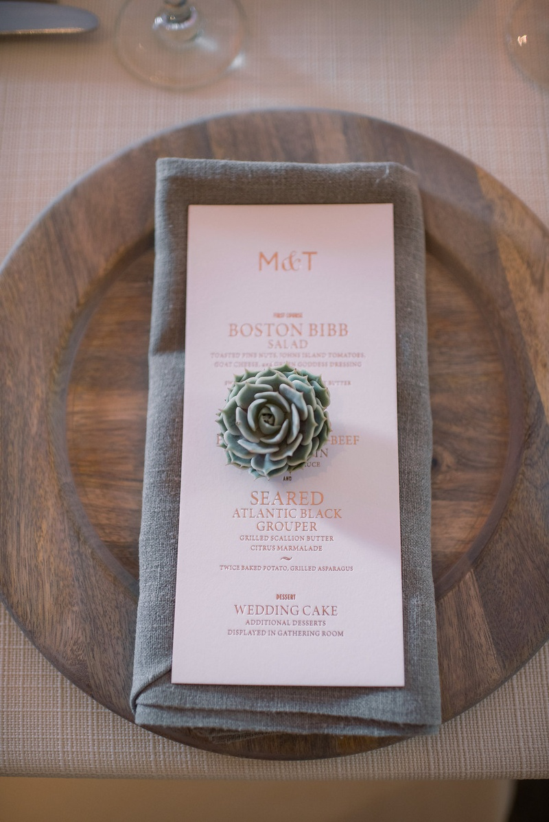 wedding menu with rose gold writing, succulent, grey napkin, wooden charger