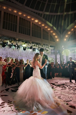 bride in galia lahav wedding dress from bridal reflections first dance with groom new york library