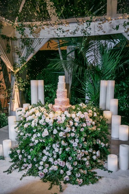 wedding reception cake table with hundreds of flowers greenery ombre ruffle wedding cake tent