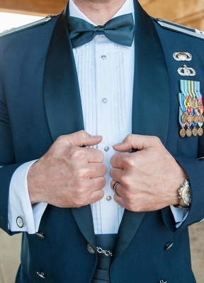 Groom in bow tie and formal officer military uniform