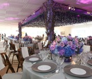 pink purple and blue flowers in low table arrangement in front of dance floor with flower structure