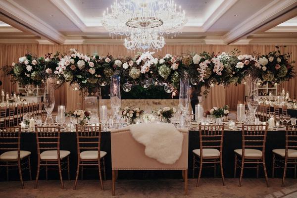 Suzanna Villarreal and Alex Wood LA Dodgers wedding reception fall decor tall centerpiece fur