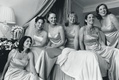 Black and white photo of bridal party in hotel