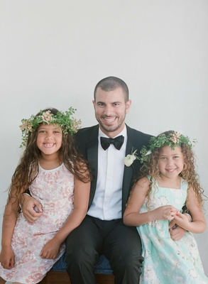 Flower girls with curly hair and greenery flower crowns