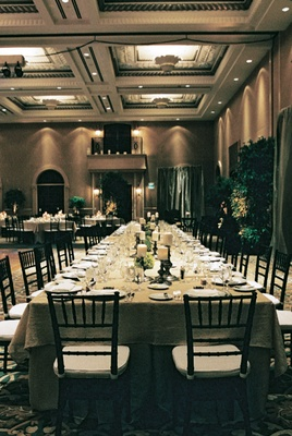 Architectural ceilings of ballroom with neutral wedding decorations
