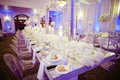 Silver sequin head table with lush floral centerpieces