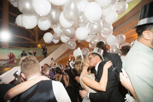 Bride and groom kissing on NYE dance floor