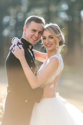 Bride and groom wedding portrait groom in military dress blues uniform