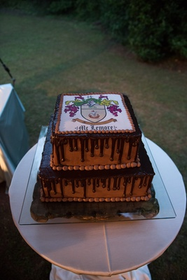 chocolate drip cake, groom's cake with family crest on top