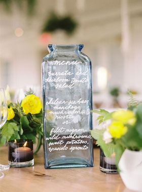 Wedding reception alternative menu idea blue vase vessel bottle calligraphy selections
