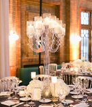 Round reception table grey linen with crystal table number white flowers candles tall lucite candle