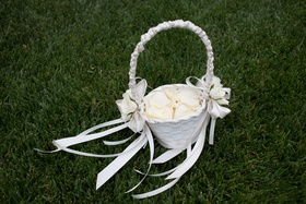 Opulent same sex wedding ceremony reception in san diego ca white flower girl basket with ivory rose petals and white ribbon mightylinksfo Images