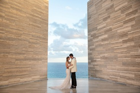 wedding portrait couple in san jose del cabo mexico modern hotel solaz berta wedding dress white tux