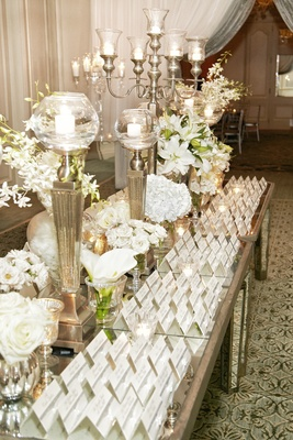 Mirror tabletop with candelabrum and seating cards