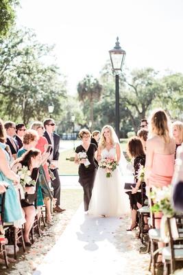 bride in mark ingram wedding dress outdoor south carolina wedding mother of bride walking down aisle