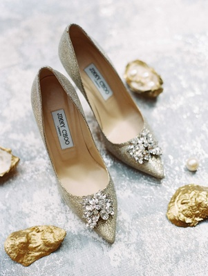 Jimmy Choo sparkly gold pointy toe pumps with jewels on toes