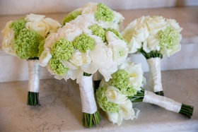 wedding bouquets with white roses and ranunculus and green hydrangeas