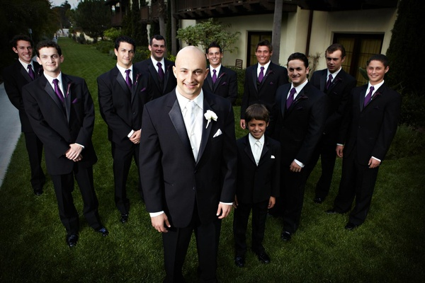 Groom with ring bearer and groomsmen in purple ties