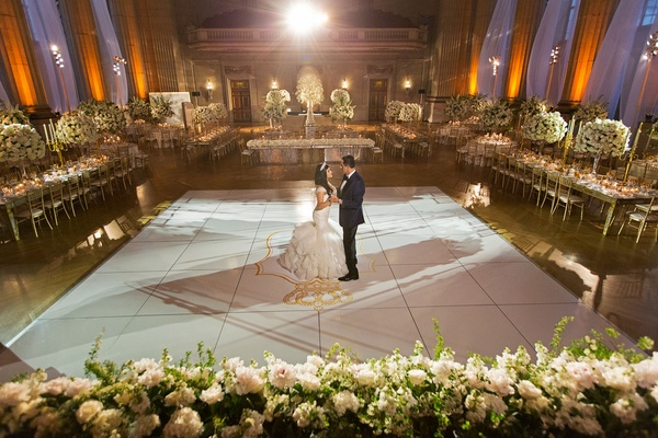 Bride and groom on dance floor gold monogram no guests white gold reception decor opulent wedding